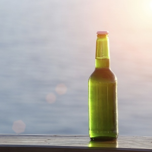 Bottle of beer on the beach