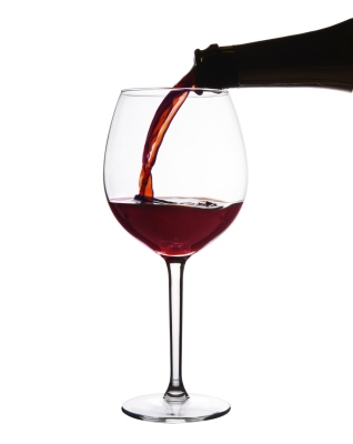 Red wine pouring into wine glass.
