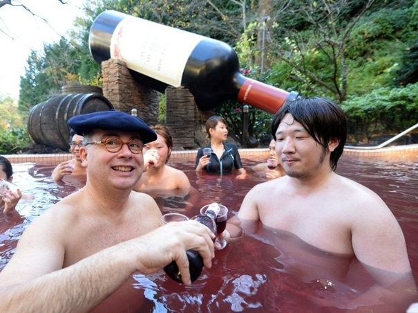 Thibault Garin in a swimming pool of Beaujolais Nouveau in Japan.jpg