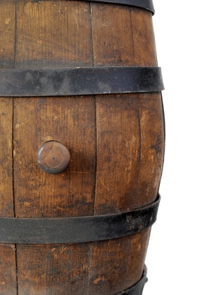 Old wooden barrel with stopper